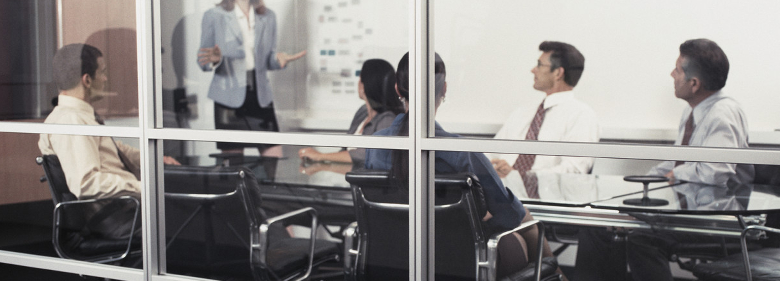 Businesspeople in Meeting --- Image by © Royalty-Free/Corbis