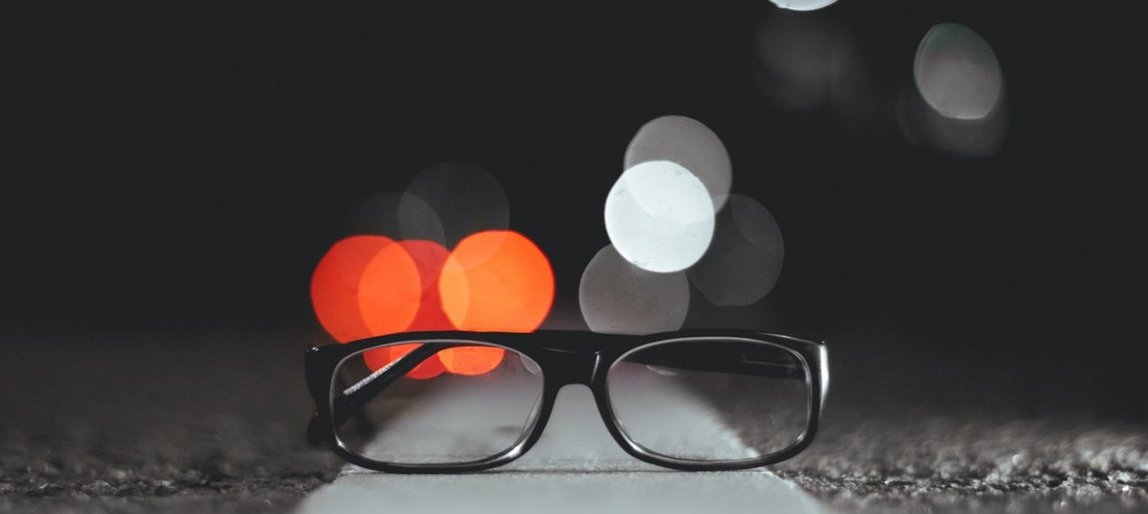 glasses and out of focus lights