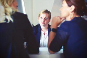 three business women talking