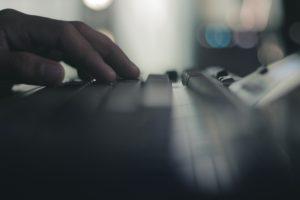 hand on computer keyboard